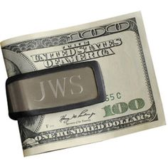Perfect for the budding business mogul or dapper gent, this sporty money clip showcases an engraved monogram. Product: Persona...