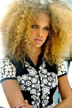 Blonde hair blue eyes black African-American beautiful woman