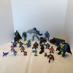 26 Assorted Action Figures Batman, Joker, Riddler, Bat mobile, Robin And More