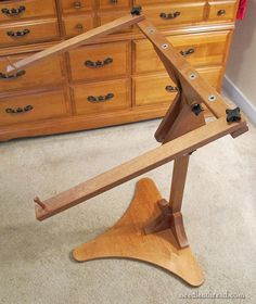 """Just-a-Thought Needlework Stand. If you don't have a floor stand and you use frames of various sorts, and if you live in the US, the JAT is a great stand to get! The pros are abundant: it's well-made; it's stable; it's easy to assemble; it's attractive; it's affordable. The only """"cons"""" (depending on how you look at it) is that it is not easily collapsible or transportable. But – it's hard to count those as cons....click through to read very informative full review."""