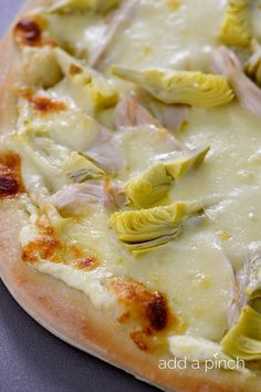 Chicken Artichoke Pizza makes one of the most delicious homemade pizzas! // addapinch.com