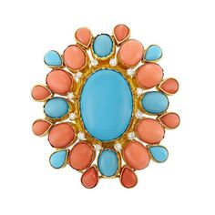 <b>Gold, Composite Turquoise, Coral and Diamond Pendant Clip-Brooch</b> <br /> 14 kt., centering one oval cabochon turquoise approximately 24.45 x 18.05 mm., surrounded by 12 round diamonds approximately .70 ct., framed by pairs of 8 oval cabochon coral, spaced by 4 oval cabochon turquoises, edged by alternating pairs of 8 pear-shaped cabochon coral and 4 pear-shaped cabochon turquoise, approximately 17.3 dwts. <br />  <br /> C