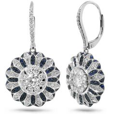 A pair of art deco inspired diamond, and sapphire earrings. Set with 1.48 carats of diamonds, and 0.43 carats of sapphires, all set in 14 karat white gold.