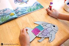 """This rainbow fish craft is the perfect companion to the beloved book """"The Rainbow Fish."""" It is so bright and colorful - kids love it! Rainbow Fish Bulletin Board, Fish Bulletin Boards, Rainbow Fish Crafts, Beloved Book, Sunday School Crafts, Kindergarten, Preschool, Bright, Colorful"""