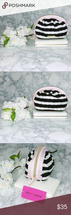 🌸🆕 Betsey Johnson Striped Makeup Bag Navy and white striped Betsey Johnson mini makeup bag with light pink ruffle detailing and floral lining. Gorgeous bag and the perfect shape! NWT. Betsey Johnson Bags Cosmetic Bags & Cases