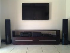 Furniture,Impressive Tv Stands For Plasma Tv With Awesome Tv Wall Unit And Classy Dark Brown Double Drawer Plus Enchanting Storage Shelves On White Tiled Floor Also Astounding Double Large Speaker,Contemporary Tv Stands For Plasma Tv