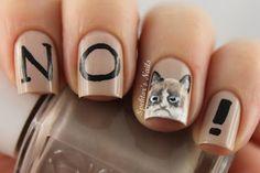 Grumpy cat inspired nail art.