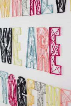 Nail and yarn wall art - maybe use small pieces of wood rather than directly on the wall - looks great!