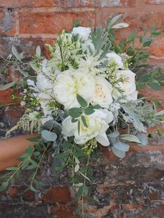 Bridal Bouquet - a lush mix of cool grey and green foliages with touches of scented ivory rose and peonies - white o'hara rose - ivory peony - astilbe - waxflower - cinerea eucalyptus - grey senecio - olive - parvifoli eucalyptus - rosemary.