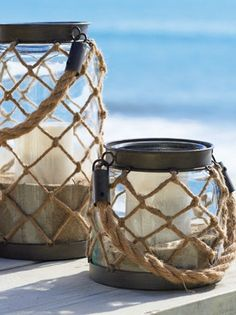 Totally adoring these nautical/Cape Cod inspired luminaries wrapped in a rope net! And those handles!