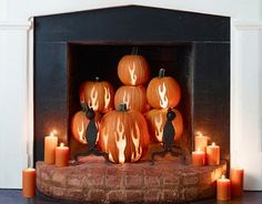 if you already don't use your firelplace, this would be great to change out those candles with - flaming pumpkins