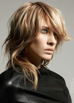 Shaggy/choppy mid-length layered blonde hair