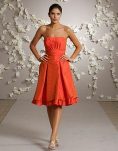 I love this coloe and the ruffles at the bottome of this bridesmaid dress. Just wish it had straps!