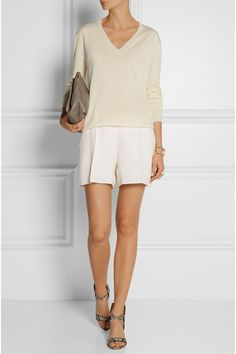 THE ROW Sabry cashmere sweater OSCAR DE LA RENTA Wool-blend shorts MARNI Trunk leopard-print calf hair shoulder bag PAUL ANDREW Lexington python sandals