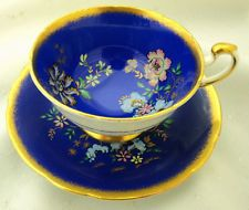 PARAGON BUTTERFLY BLUE ART DECO HVY GOLD FOOTING WIDE TEA CUP AND SAUCER