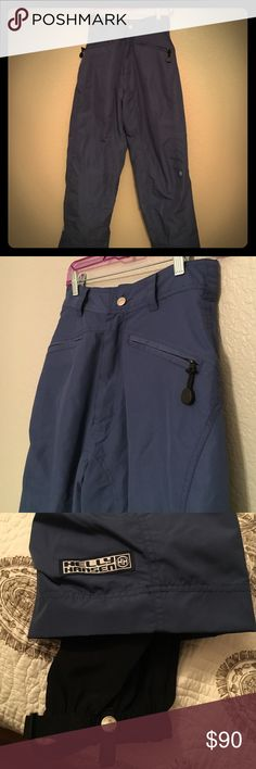 "Helly Hansen Board/Ski Pants Only worn once and in perfect condition. I've outgrown these so they need a new home! Breathable, highly water resistant (per the label), with two front zip pockets and air flex gaiter closures around ankle (to keep snow out). Navy blue, Small Petite. Approx. 14"" across waist, 14 1/2"" rise, 39"" from top of pant to bottom. Reasonable offers considered. Helly Hansen Pants"