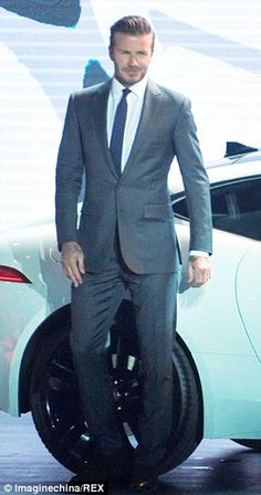 Drive it like Becks: Just one day after wife Victoria's 40th birthday in LA, the former football star was in China for the promotion