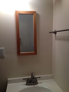 Don't forget about proportion when you're updating. The mirror above the sink is so small you can barely see your face and the light is off center.