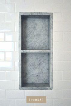 California bungalow bathroom. marble shower niche.
