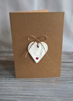 Handmade Air Dry Clay 'My Love' Removable Keepsake Heart on a plain brown card left blank for your own message – 2019 - Clay ideas Diy Air Dry Clay, Diy Clay, Clay Crafts, Clay Christmas Decorations, Polymer Clay Ornaments, Paperclay, Heart Cards, Card Making Inspiration, Biscuit