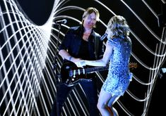 Carrie Underwood Photos Photos - Recording artists Keith Urban (L) and Carrie Underwood perform onstage during The 59th GRAMMY Awards at STAPLES Center on February 12, 2017 in Los Angeles, California. - The 59th GRAMMY Awards - Show