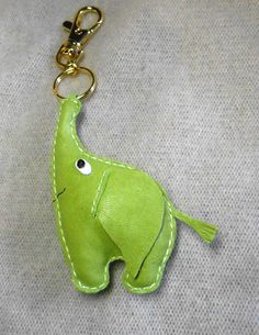 Free shipping Elephant Leather Keychain leather charm  by Yarkoko, $19.00 https://www.etsy.com/listing/168820301/free-shipping-elephant-leather-keychain?ref=af_circ_favitem&atr_uid=23339958