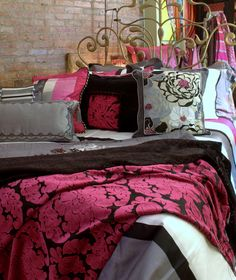 Custom made bedding and cushions in Designers Guild fabric available through Jane Hall Design.
