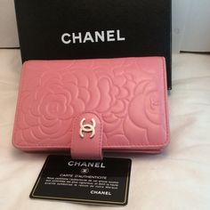 Chanel lambskin camellia tri-fold wallet 100% authentic, comes with original packing and authenticity card. Beautiful pink wallet very soft and just gorgeous! Slightly worn (see pictures) in the corners otherwise in great condition. Price reflects the wears. I'm open to negotiations! Try the offer button you just might be surprised :) CHANEL Bags Wallets