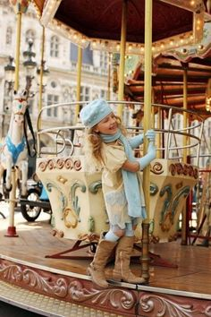 A little girl enjoying her time on a merry-go-round in Paris. Feels nostalgic...