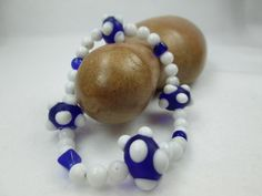 WHITE, NAVY BLUE, QUARTZ, CHUNKY, STRETCH, ARE A FEW OF THE WORDS USED TO DESCRIBE THIS UNIQUE BRACELET.  MADE WITH GLASS AND GEMSTONES, THIS LOVELY STONE BRACELET WOULD BE...