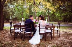 Outdoor wedding bride and groom sitting at their table