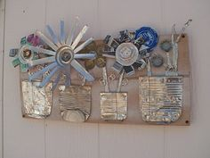 Flat cans and cut aluminum - and great link to this guy's recycle art