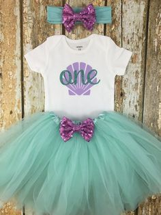"""This adorable """"One"""" mermaid birthday outfit is the perfect first birthday outfit for your little girl to wear at her party or for a cake smash photo shoot!"""
