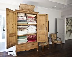 Turn your antique armoir into a lovely linen closet! Linens look great on display. (Check out the one in the bathroom!) www.cedarhillfarmhouse.com