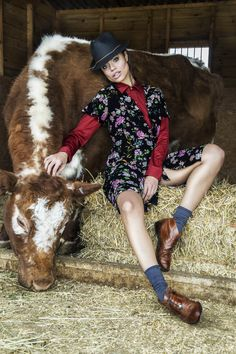 women's apparel , photography, countryside girl, country girl, country editorial, fashion , photography , cow,  woman with a cow, girl with animals