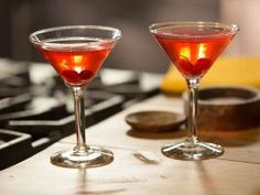 Spanish Cranberry Sparkling Martini : Bobby's homemade cranberry vodka takes center stage in this autumnal sparkling cocktail. He starts by preparing a cranberry-flavored simple syrup, then adds vodka. It's best to prepare the mixture a few days in advance—the longer it sits, the more the cranberry flavor will come through.