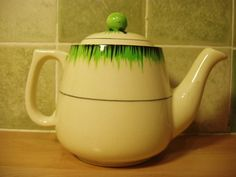 "FS: TG Green Grassmere Tea Pot, Lid in in excellent condition, the pot itself has no damage but is crazed throughout and is stained mainly on the inside but does have a little on the outside,  see pictures.  5"" high by 4 in Diameter and 6.75"" from tip of spout to handle"
