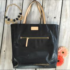 Kate Spade black tote bag Gently used tote bag, signs of wear on front of bag (white scuff marks) as pictured, hardly noticeable. Inside is in good condition, handles are in good condition. Perfect for work or school! Will fit a MacBook Pro. kate spade Bags Totes