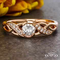 Design Your Own Unique Custom Jewelry at Green Lake Jewelry Works! Custom 14kt rose gold half wrap braided with diamond accent taper details