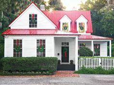 I'm just pinning this because I LOVE the red roof and the white house!  If I ever build a house I'm going red roof!  super cute!