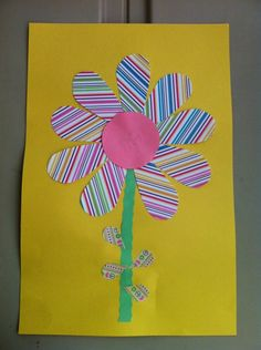 Construction Paper and Scrapbook Paper Scraps Flower Craft for toddlers and preschoolers.