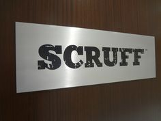 Etched interior corporate door sign NYC - brushed aluminum etched plaque mounted onto wood paneling. We specialize in custom corporation signage in New York, NY. Visit our website below to contact us for a free consultation! http://www.SignsVisual.com