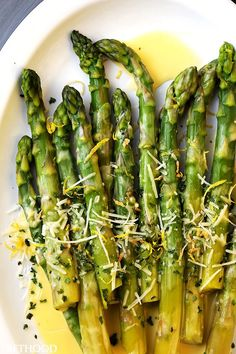 Asparagus with Lemon Butter Sauce - Budget friendly quick and easy crisp-tender asparagus drizzled with an amazing lemon butter sauce and a sprinkle of parmesan cheese. The BEST asparagus side dish of ever!