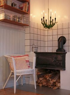the wood stove. bricked/tiled in Amelie, Exterior Design, Interior And Exterior, Old Stove, Brick Tiles, Kitchen Essentials, Coffee Cups, Entryway Tables, Sweet Home