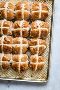 These homemade Hot Cross Buns are as traditional as they come! Soft and fluffy with juicy raisins and a sweet glaze top, they're perfect for Easter!