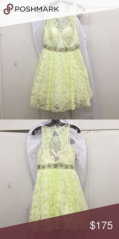 White dress w/ lime green tracing lace flowers White dress with floral lace flowers. Neon green/yellow thread traces the flowers. Sleeveless. Many layers of tule. Gemstones and sequins surround the waist of the dress. Dave and Johnny Dresses Prom