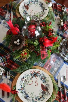 Christmas table with tartan plaid and hurricane centerpiece with evergreens and Cardinals | homeiswheretheboatis.net #Christmas #tablescape #LynchCreekFarm