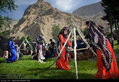 Kurdish Women in traditional Dresses and Headgears in Kirmaşan, Iran.