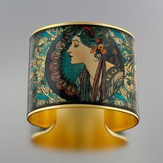 Brass cuff with image sealed in resin. very cool.