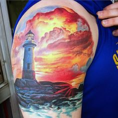 Mens Lighthouse And Ocean At Sunset Upperarm Tattoo